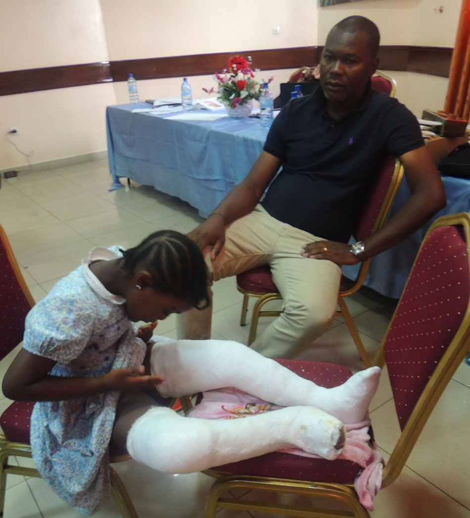 Mr Atuga and her daughter Shama after her treatment at the workshop
